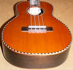 Mainland cedar top ukulele.  I have one of these.  It is my favorite ukulele.  I love it.  When I play it I can also smell the cedar.