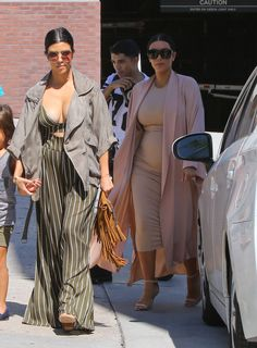 Kourtney's crop top showed off lots of cleavage! She finished her look with huge round statement sunglasses and a fringe bag. Image Source: Getty / Bauer-Griffin
