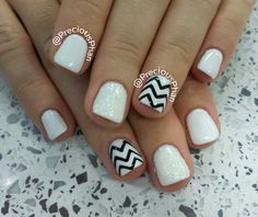 White and black chevron nails, with a white glitter.