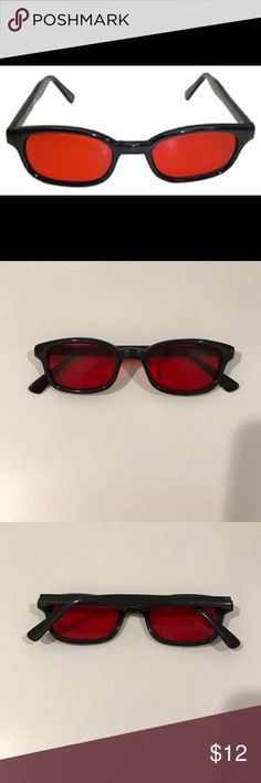Black frame motorcycle glasses with red lens Black frame biker motorcycle glasses with red lenses - get wicked with the Harley Davidson crowd. Lenses are ANSI Z80.3 rated. Good wind seal rating. These moto glasses are in great condition, and would probably fit small to medium sized heads best. UV protection. When you stare out these glasses, everything is tinted red. Accessories Glasses