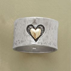 "HEART AND SOUL RING -- Marrying precious metals and textures, a heart hand cast into our 1/2"" wide hammered sterling band frames another of smoothly finished 14kt gold. A Sundance exclusive in whole and half sizes 5 to 9-1/2."