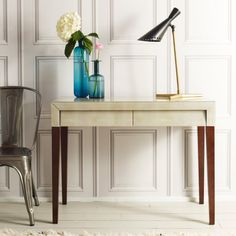 Reminiscent of 1920s style, this ivory shagreen effect desk will add glamour and style to your home office.