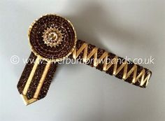 Brown glitter velvet and mocha edged gold satin sharkstooth show browband shown with standard pointed flags.  www.silverburnbrowbands.co.uk