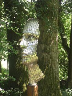 Metal Face Sculpture at Hannah Peschar Sculpture Garden, Ockley, Surrey - http://www.hannahpescharsculpture.com