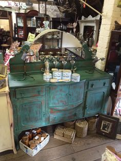 1930's sideboard painted in Provence and Florence painted by Lisa Ard for her store in Tallahassee, Florida, USA.