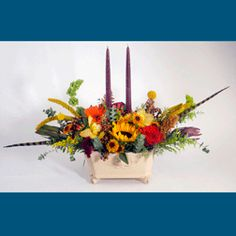 HARVEST FESTIVAL:  A gorgeous assortment of Autumn flowers designed in a footed ceramic container. Perfect for a table - with or without candles!    #MatlackFlorist