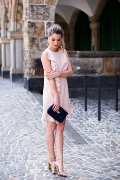 Wedding guest outfit inspo - pink dress with ruffles and statement earrings