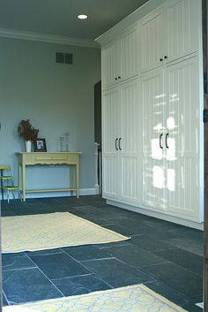 Doors to cover hanging closet would look cleaner - but it is still the mud room?  Decisions....