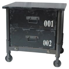 Lend an industrial-chic touch to your parlor or study with this 2 drawer cabinet, showcasing a weathered finish and castered base.  ...