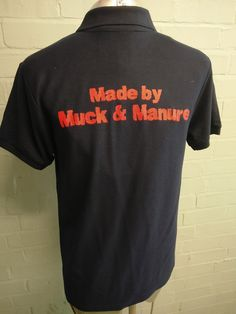 "Black short sleeved polo tees with custom embroidered logo on for Aylesbury Juniors Young Farmers Club. With custom print on the back in red ""Made by Muck & Manure""."