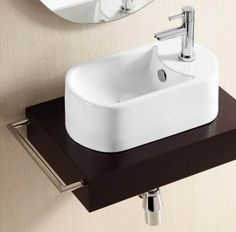 small is beautiful - this Teramo basin is only 40cm x 23cm - very cloakroom cute www.clickbasin.co.uk