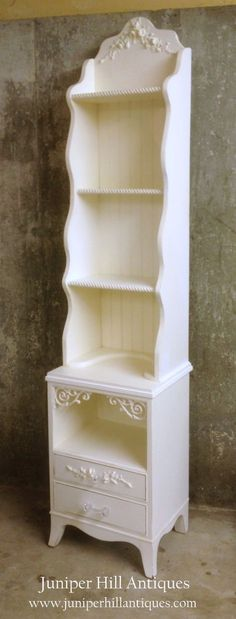 upcyled from a night stand, we have added a whimsy bookcase top, crystal pulls and pretty rose appliques! #shabbychic #whitepaintedfurniture