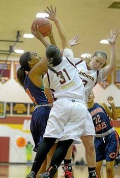 Genessa Bedoya (31) and Alyssa Fisher battle Devin Stanback of Chaminade. Next matchup is Feb 11