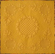 Mini whole cloth Sunflower quilt at Anita Shackelford Designs.  The digitized design is available.
