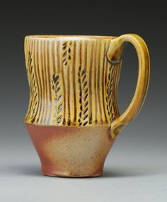 Carved Mug, honey amber and earth tones, hand carved textures, wood and soda fired stoneware. $36.00, via Etsy.