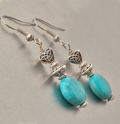 A personal favorite from my Etsy shop https://www.etsy.com/listing/584150110/heart-earrings-silver-and-green-heart