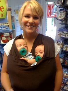 I'll have to ask my mommies to multiples if any of them have tried this before.   A better option for carrying twins?  This was recommended by other twin moms. Moby wrap.