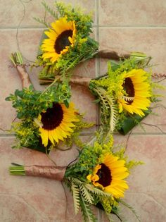 Single large sunflower with ferns, etc. ~ pretty bridesmaids bouquets.