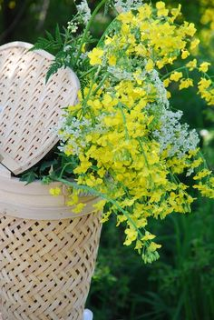 wildflowers peeping out of lidded baskets