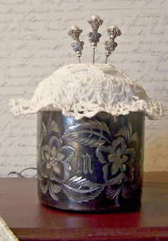 """Pincushion from a silver baby cup with a vintage doily.  Impressed and etched with the letter """"M""""."""