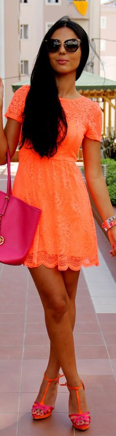 Awesome, bright, and totally orange short dress. Perfect combo with the heels, the designer sunglasses, and the handbag. The entire outfit works amazingly with the model's outstanding tan.
