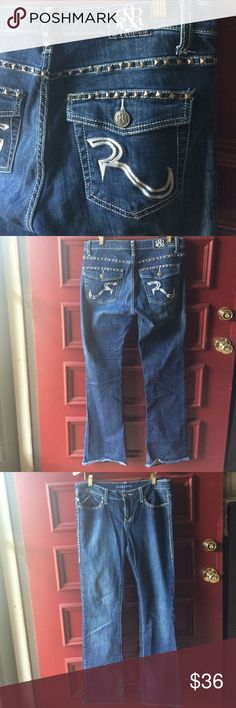 """Rock & Republic Kasandra Bootcut Stud Jeans 8M Very good pre-worn condition. These measure 32"""" at the waist (taken flat), 33"""" inseam with a 9"""" rise-- mid-rise.  Indigo shade. Silver R stitching with pyramid shaped pewter color  studs. 98% cotton, 2% spandex. Rock & Republic Jeans Boot Cut"""