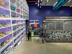 Polished, sealed concrete flooring flows through the Mapos-designed Asics store in New York. #interiordesign #interiordesignmagazine #design #projects #retail #concrete #flooring