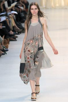 antonio marras                                                                @Laura Komai, actually more subdued and more flowy than ruffley.