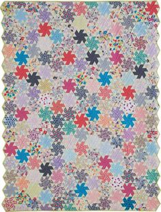 Wyoming Whirligig Quilt Kit: Get a convenient kit for the scrap quilt look of Wyoming Whirligig, a large throw-size foundation paper pieced quilt designed by Teri Coffman.