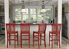 painted red bar stools - I totally want to do this, but Dave's not into it (I am going to drag him to the dark side with me )
