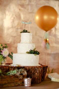 put a giant gold balloon behind your cake because it will make your guest smile. it made me smile and i wasn't even there! http://www.weddingchicks.com/2013/11/21/mint-and-gold-wedding/