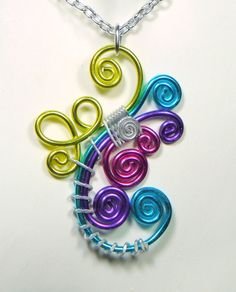 Colorific Spiral Pendant Chain Necklace -- This reminds me or mermaids and the sea in vibrant colours.