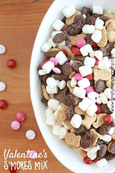 such a great treat for the kids --> Make a non-messy smores mix with this easy to make Valentine's S'mores Mix. Minimal ingredients but so much to enjoy! #valentines #valentinesday #valentinesdayideas via @simplymommy