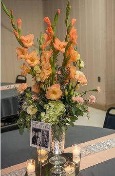 Centerpiece: Fresh light peach gladiolus, fresh white hydrangeas sprayed fresh…