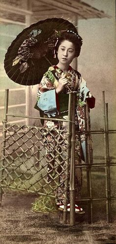Studio Geisha at the Bamboo Gate.   Ca.1890s Large format photograph by an unknown Japanese photographer. S)