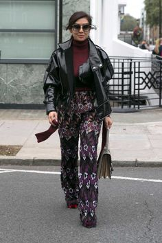 Liz Uy in Self Portrait pants with Gucci bag on the street at London Fashion Week. Photo: Emily Malan/Fashionista.