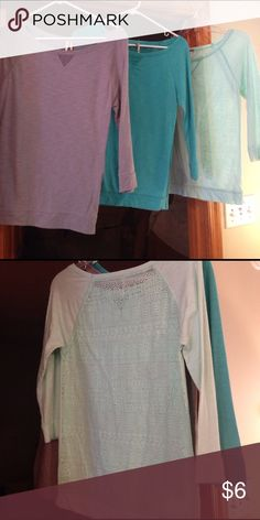 Shirts like new See through lace pattern in back. Cute with tight tank underneath. Three quarter length sleeves. Will sell each for $6 or together for $12 Poof! Tops Tees - Long Sleeve