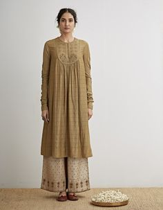 Check out our Pale Olive Embroidered Kurta Set by Dhruv Singh available at Ogaan Online store at special price. This collection pays homage to the rich textile traditions of India with a pared-down aesthetic that translates into timeless pieces Simple Pakistani Dresses, Indian Dresses, Indian Outfits, Indian Designer Outfits, Designer Dresses, Casual Dresses, Fashion Dresses, Kurta Designs, Dress Designs