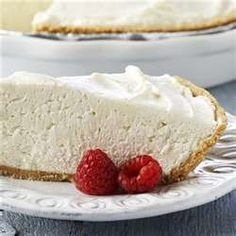 No Bake Cheesecake  2 8-oz pkg cream cheese (softened)  1 cup sugar  1 pkg dream whip  Milk  Vanilla  Graham Cracker crust  Mix dream whip with milk and vanilla according to directions on pkg. In separate bowl, blend cream cheese and sugar until sugar dissolves. Fold dream whip into cream cheese and sugar mixture. Pour into graham cracker crust and chill. Top with favorite fruit topping.