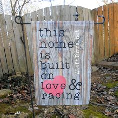 """""""This home is built on love & racing"""" garden flag. These flags are perfect for your home, campsite or pit space. race track, speedway, home decor outdoors"""