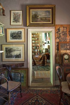 In the 'snuggery', charcoal drawings by Julienne hang beneath a landscape inherited from her grandmother and...