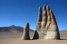 "The ""Mano del Desierto,"" or Hand of the Desert, is a sculpture by famous Chilean sculptor Mario Irarrazabal created in the 1980s. It is located in the Antofagasta Region in the Atacama Desert.  I'd love to help you plan your trip to see this sculpture, call me or send me an email when you're ready to start planning.  #Chile #VisitChile #VisitSouthAmerica #TravelPlanning #AtacamaDesert #ManodelDesierto #HandoftheDesert #Sculpture #MarioIrarrazabal #UnusualSculpture #JETTravel Places Around The World, Around The Worlds, Chili, Kids Attractions, Thing 1, African Safari, Bolivia, Minneapolis, Cool Places To Visit"