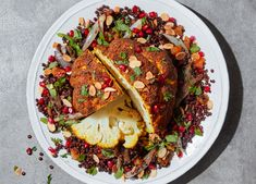 Whole roasted cauliflower spiced with turmeric, cumin and coriander. Serve this delicious vegan recipe with green lentil salad. Visit sainsburys.co.uk for more