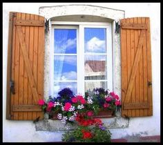 Love this window, shutters, and planter!