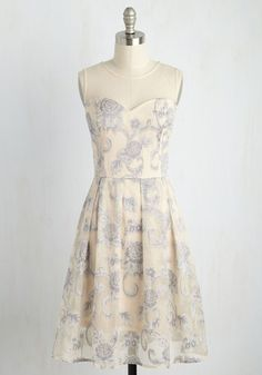 Your spontaneous lifestyle means impromptu parties happen on the reg. Good thing you keep this taupe dress handy, because its slate blue, embroidered flowers, classic illusion neckline, and perfectly pleated skirt are a snap to sport, style, and savor for whatever soiree comes your way!