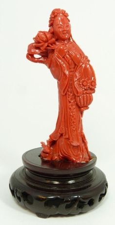 CHINESE QING DYNASTY CARVED ALL NATURAL RED CORAL FIGURE OF GUANYI