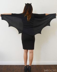 Have a black dress, hot glue and a couple minutes? Then you've got yourself a super cute bat costume