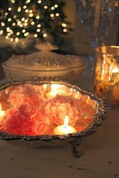 Victorian and magical...candle with flowers floating in silver serving dish. Ahhh...the romance of the flame!