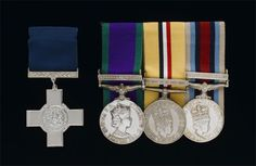 George Cross and service medals awarded to Corporal Mark W Wright, 3rd Battalion the Parachute Regiment, for service in Northern Ireland, Iraq and Afghanistan between 1999-2006. The George Cross (on the left) was awarded posthumously for gallantry.