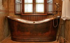 Google Image Result for http://files.idealhomegarden.com/files/commons/rustic_lodge_bathroom_copper_bathtub.jpg